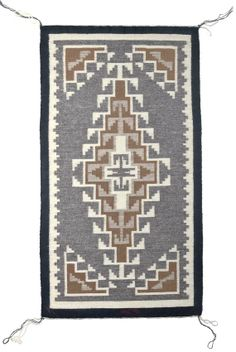 Another Two Grey Hills rug woven by Daisy Taugelchee.