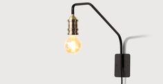 Lampada da parete Starkey, nero e ottone