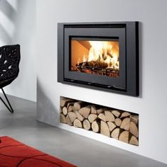 Insert stove with logs underneath - Wood Burning Fireplace Inserts Wood Storage, Stove, Modern Stoves, Wood Fireplace, Fireplace, Wood Burning Stove Insert, Home Fireplace, Wood Burning Fireplace Inserts