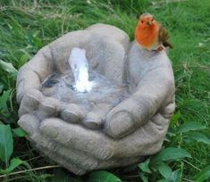 Hands and Robin Water Feature......no Diy BUT! You can use the hypertufa hands recipe for this project. Just create a hole for the tubing to go through for the water.