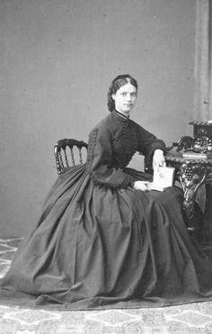 Dagmar sitting wearing a crinoline