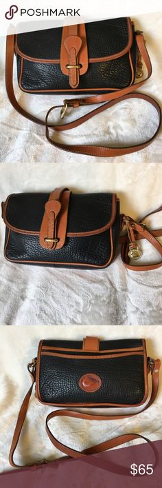 Dooney &Bourke black/brown equestrian style bag Dooney & Bourke black/tan Pebbled leather equestrian style bag.  Very good vintage condition with a darkening of the tan leather in some areas. Dooney & Bourke Bags