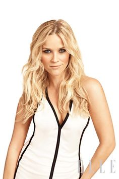 Reese Witherspoon wears a white viscose jersey dress with black trim from Emporio Armani.