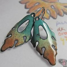"Enameled Leaves by Patsy Oxley of OxOriginalArtJewelry. ""For years I labored at my easel to capture the essence of our arid environment in paint. From the moment I fashioned my first piece of art using wire and beads - a simple bookmark - I knew that my artistic hunger had found a new dimension."""