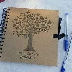 Check out this item in my Etsy shop https://www.etsy.com/uk/listing/266890921/personalised-wedding-guest-book-free