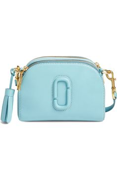This pretty azur blue Marc Jacobs camera bag is the perfect accessory to add some color to any look.