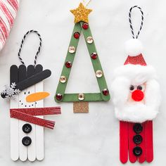 christmas kids POPSICLE STICK CHRISTMAS ORNAMENTS - these are so cute and fun to make! Make a snowman, Santa or Christmas tree. Perfect for kids to help make and then you can hang them on the tree as ornaments! Easy Christmas craft for kids. Popsicle Stick Christmas Crafts, Easy Christmas Crafts, Diy Christmas Ornaments, Craft Stick Crafts, Homemade Christmas, Simple Christmas, Diy And Crafts, Christmas Gifts, Popsicle Sticks