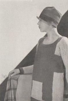 Vogue (Paris) February 1927 Le Sweater de Laine Tricotée on Renouvelle sa Décoration Schiaparelli La disposition originale des rectangles blancs, se détachant sur le fond brun fait tout le chic de ce çhandail, spécialement dessiné pour le sport. Photo Hoyningen-Huene