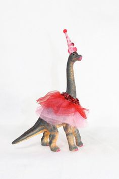 This is a Custom Order Brontosaurus. You tell me your party colors, and I will make you a custom tutu and hat/crown to adorn you dinosaur.