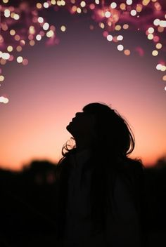Beautiful picture of a young girl's silhouette against a magical background.