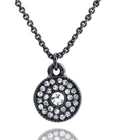 Add a shiny splash of sophistication to outfits with this glitzy necklace. Vibrant rhinestones are set against a sleek black pendant that's suspended from an adjustable chain to offer a perfect, custom fit for growing girls.