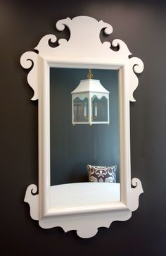 oomph Charleston Mirror in Dove White with a reflection of the oomph Hobe Sound lantern.