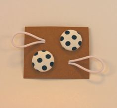 fabric-covered button ponytail holders