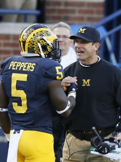 Michigan DB Jabrill Peppers gets a smile and handshake
