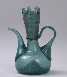 Ewer Date: century Geography: Iran Culture: Islamic Medium: Glass; free blown with applied decoration Five Thousand, Silk Road, Prehistory, Museum Of Fine Arts, Bottle Design, Antique Glass, Hand Blown Glass, World Cultures, Colored Glass