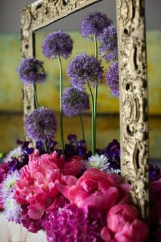 floral art design - flower arrangement art installation with allium, dahlias, peonies, sweet peas, and hydrangea.