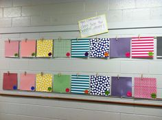 A cute way to display student work!  Laminated scrapbook paper with a clothes pin hot glued to the top.  Super easy and super cute!