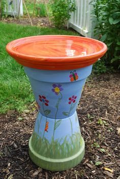 Old terra cotta pots make a great bird bath upcycle!