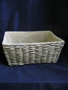 Concrete basket planter.