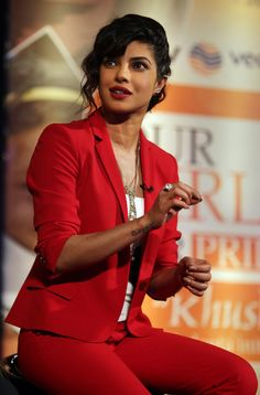 Priyanka Chopra looking chic in a bright cherry tailored suit sporting a pleasant hair-do. #Bollywood #Style #Fashion