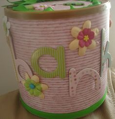 Any kind of can with plastic lid.  For Barbie accessories, crayons, etc.