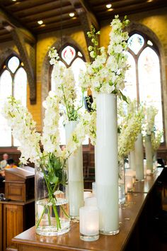 Tall vases of sweet pea and candles. Robert Exoo. Photography: Anouschka Rokebrand Photography - anouschkarokebrand.com  Read More: http://www.stylemepretty.com/destination-weddings/2014/01/20/white-silver-netherlands-wedding-at-librije/