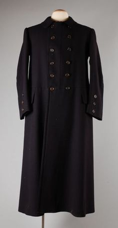 1880 Coat Culture: Dutch Medium: wool Dark coachman uniform with two pockets, a double row of buttons and lined with deposit.