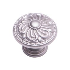 This satin nickel finish cabinet knob with ornate design is part of the Augustine Series Cabinet Hardware Collection from RK International and is a perfect blend of craftsmanship in traditional and contemporary design to complement any decor.