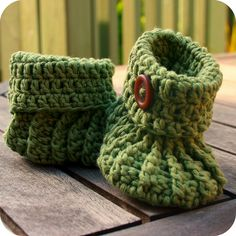 Green button crochet booties by coffee n crochet, via Flickr