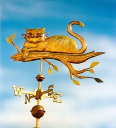 Cheshire Cat Weather Vane by West Coast Weather Vanes.  This custom made handcrafted Cheshire cat weathervane was made using a variety of metals.