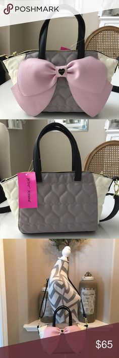 "Betsey Medium  Nanza Grey Satchel Gorgeous color combination of cream, grey, black with a soft pink bow. Fully adjustable detachable shoulder strap & 5"" handle drop. 1 lg. & 1 smaller inside slip pocket & zip pocket. Bag zips at top. NWT Betsey Johnson Bags"