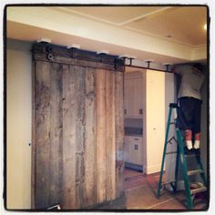 This is a barn door made of reclaimed wood from a barn. Made by my husband and installed in a house in Newport Beach.