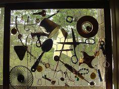 Garden Window Art.  Chicken wire on old picture frame, add your stuff, prop in window.