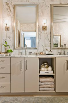 What I love about this bathroom design is the clean lines and flat panel cabinets with beautiful cabinet hardware. The hardware is repeated in the light fixtures and the faucet handles.  Great idea for Bathroom Home Remodeling project. Interior Design Ideas