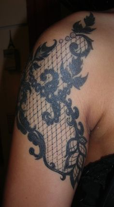 front side of black lace quarter sleeve tattoo