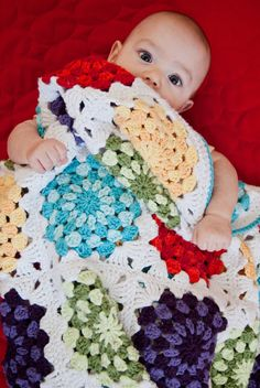 The most common kind was granny square blankets in a single neutral color. For my second baby I wanted to make him his own granny square blanket. I wanted more color than my grandmothers so I modified the traditional sunburst square to have larger spots.