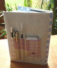 I would like to have removable pockets for essentials attached to various books with covers, tablets and covers, and notebooks. Great idea!