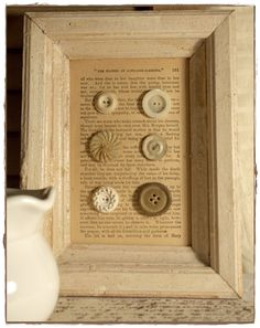 framed old book page with buttons