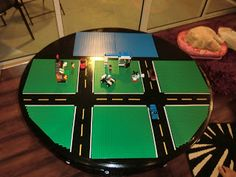 """Lego Table.. I like the roads .. But maybe use magnetic """"road"""" tape instead"""
