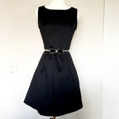 Sissia Classic LBD Brand new with tag. Neoprene-like material. Fitted up top and flared in the bottom. Labeled Large but runs very small and will fit small better. Made in Italy. Does not come with the belt. Sissia Dresses Strapless