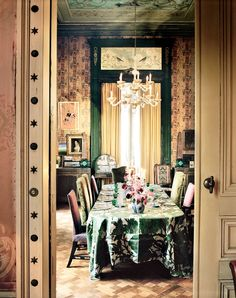 Dries Van Noten's dining room. A repurposed length of Mantero silk brocade dresses the dining-room table.