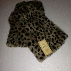 Boot covers/ leg warmers Leopard print faux fur boot covers or leg warmers with tags. Never worn. Accessories