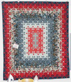 Blooming nine patch in tomato soup reds and colonial blues, by Elena's Treasures
