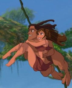 TARZAN - ok. So he's carrying her with both of his arms, then holding BOTH of them up with his TOES!!! Dude!!!!