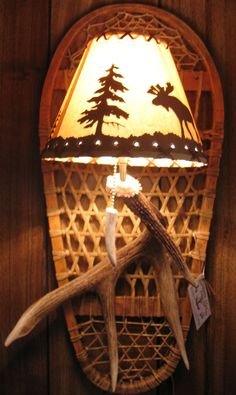 Snowshoe antler light sconce