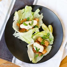 Paleo Fish Tacos.  Fish fried in coconut oil with spiced up coconut flour batter, lettuce tacos, salsa, and white sauce!