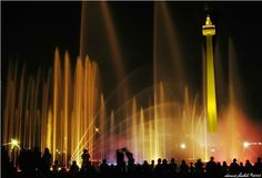 """Monas or National Monument is the 132-meter tower in the centre of Merdeka Square, Central Jakarta. Symbolizing the fight for Indonesia, gold-plated flame on top means burning fighting spirit.  Designed based on masculinity and femininity """"lingga"""" and """"yoni"""" principle, the monument can also be interpreted as """"alu"""" and """"lesung"""", traditional rice pestle. Inside there is museum.  Nearby: Taman Mini Indonesia Indah, Kepulauan Seribu (Seribu Islands)"""