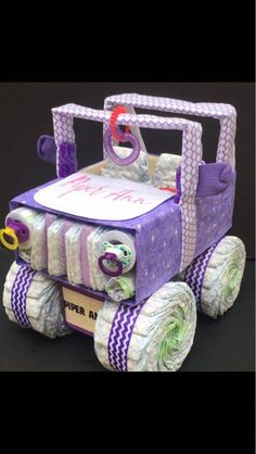 Looking for a purple baby shower gift? This ADORABLE purple diaper jeep This purple Diaper cake is FULLY LOADED with: size 1 Luvs diapers washclothes recieving blankets pacifiers sleeper pair of infant socks teether ring length toys *********OPTIONAL AT Baby Shower Cakes For Boys, Baby Shower Themes, Baby Shower Gifts, Shower Ideas, Luvs Diapers, Baby Shower Diapers, Baby Shower Purple, Purple Baby, Jeep Diaper Cake