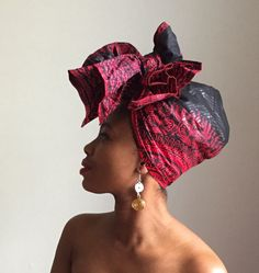 This is a must have headwrap. This scarf is made from 100% cotton Ankara wax print fabric. Crown your head with these beautiful hand selected African print scarf. This vibrant Red and Black Dashiki headscarf is meticulously hand finished. This headwrap has a glossy finish. It measures approximately 70 x 20 (175 cm x 50cm) each, giving you enough fabric to reproduce the style shown above and much more.  All headwraps are handmade in Montreal. Measurements may vary slightly.  Wash cold with…