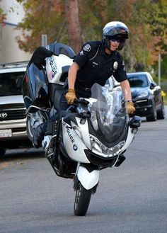 """The cop says """"  If you do this on your motorcycle I will write you a ticket for $400""""."""